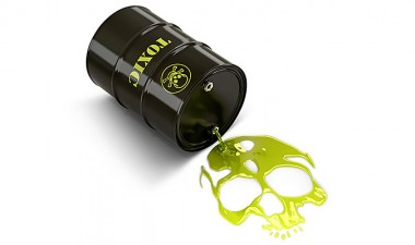 Barrel labelled 'toxic' spilling green goop into the shape of a skull.