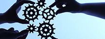 Image of hands holding gears in a circle
