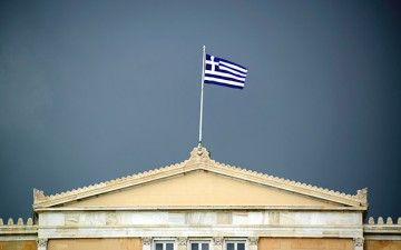 Image of a building with a Greek flag