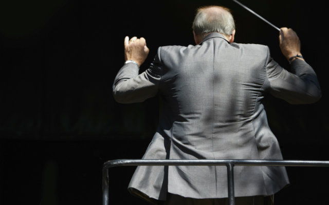 Image of a conductor conducting an orchestra