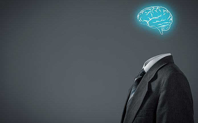Image of a suit standing with a glowing brain above it
