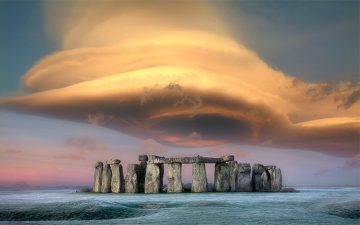 Image of Stonehenge with a giant cloud overhead