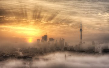 Image of a sunrise over the Toronto skyline with the CN Tower