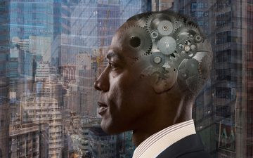 An African-American man stares out a window with cogs superimposed over his brain