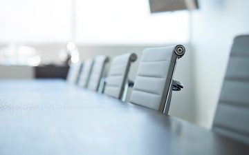 Row of empty chairs in board room