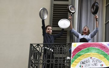 image of a woman and a boy holding pans up in the air