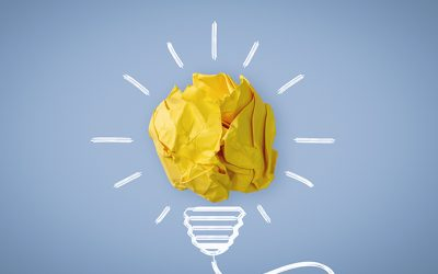 New Idea. Crumpled Paper Ball Glowing Bulb Concept.